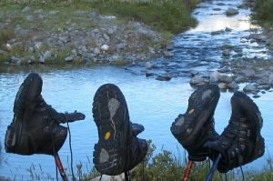 drying-tramping-boots-river